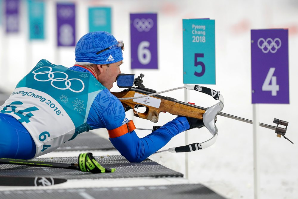 Lowell Bailey, of Lake Placid, looks at the targets before shooting during the 10-kilometer biathlon sprint Sunday at the 2018 Winter Olympics in Pyeongchang, South Korea. (AP Photo — Andrew Medichini)