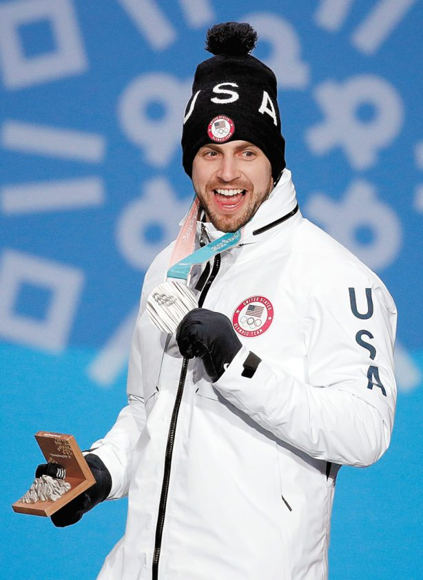 Chris Mazdzer accepts his Olympic silver medal Monday for the men's singles luge competition in Pyeongchang, South Korea. (Associated Press photo)