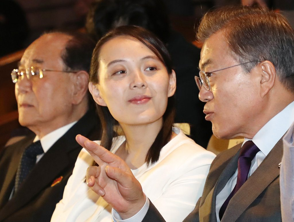 """South Korean President Moon Jae-in, right, talks with Kim Yo Jong, North Korean leader Kim Jong Un's sister, during a performance of North Korea's Samjiyon Orchestra at National Theater Sunday in Seoul, South Korea. At left is North Korea's nominal head of state Kim Yong Nam. A rare invitation to Pyongyang for South Korea's president marked Day Two of the North Korean Kim dynasty's southern road tour, part of an accelerating diplomatic thaw that included some Korean liquor over lunch and the shared joy of watching a """"unified"""" Korea team play hockey at the Olympics.  (Photo via AP — Bee Jae-man/Yonhap)"""