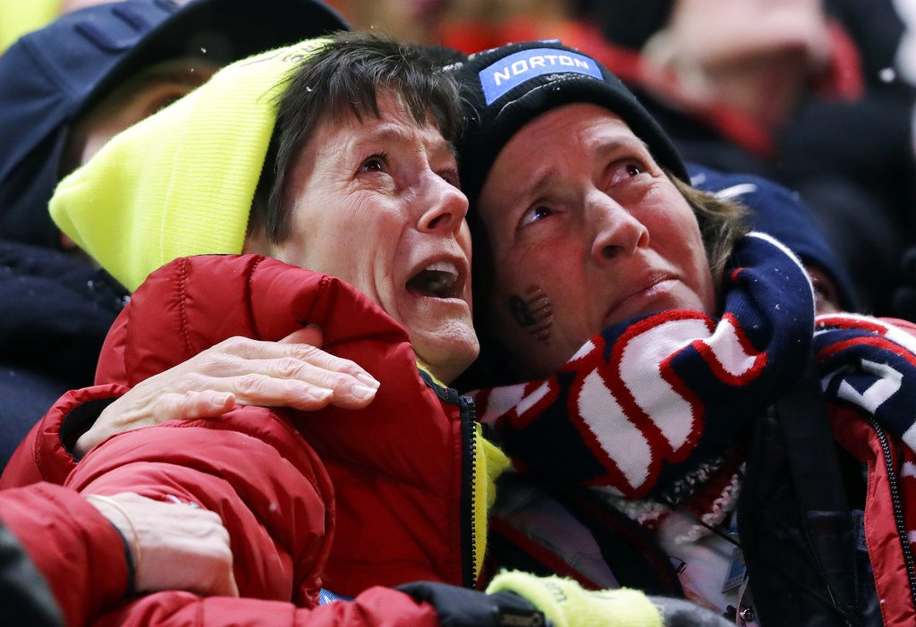 Sue Sweeney, left, the mother of Emily Sweeney of the United States, cries out as her daughter crashes on the final run during the women's luge final at the 2018 Winter Olympics in Pyeongchang, South Korea, Tuesday. (AP photo — Wong Maye-E)