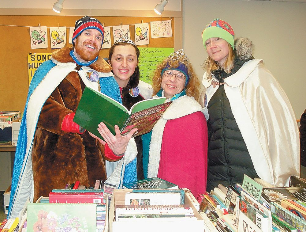 Chamberlain Drew Benware, Princess Victoria Smith, Queen Nancy LaBombard and Archbishop Christine Bell visited the 29th annual Winter Book Sale at the Saranac Lake Free Library on Friday, Feb. 9. (Photo provided —  Pat Wiley)