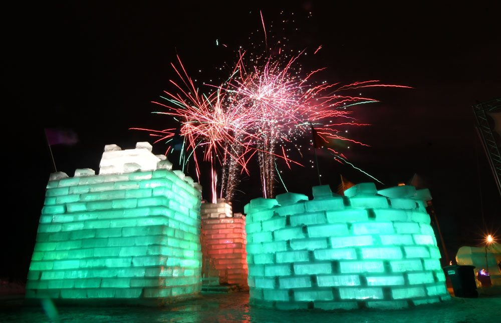 "Fireworks burst over the Ice Palace to close the Saranac Lake Winter Carnival Sunday night. NBC's ""Today"" show will broadcast from the Palace Thursday morning as people gather there to watch Saranac Lake's Chris Mazdzer race live in the Olympic luge team relay. (Enterprise photo — Lou Reuter)"