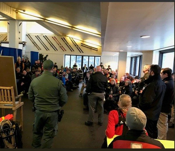 """Dozens of searchers gather for a briefing on the search for Constantinos """"Danny"""" Filippidis in the lodge at Whiteface Mountain Ski Center recently. (Photo provided by the New York State Department of Environmental Conservation)"""