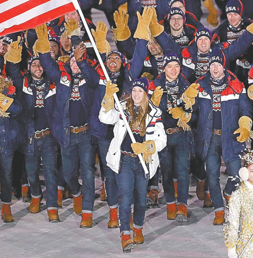 Luger Erin Hamlin from Remsen carries the flag of the United States Feb. 8 during the opening ceremony of the 2018 Winter Olympics in Pyeongchang, South Korea. (AP photo —Michael Sohn)