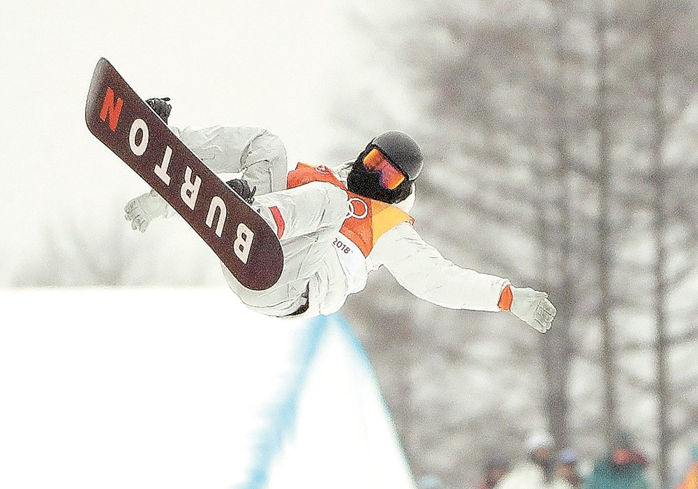 Shaun White jumps during the men's halfpipe finals Wednesday at Phoenix Snow Park in Pyeongchang, South Korea. (AP photo — Gregory Bull)