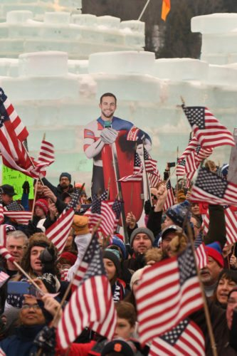 A cutout of Chris Mazdzer appears to be looking out over the massive crowd assembled at the Winter Carnival Ice Palace this morning for a watch party to view the luge team relay race live from the Winter Olympics in Pyeongchang, South Korea. (Enterprise photo —Lou Reuter)