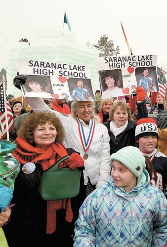 Saranac Lakers Beryl Szwed (holding green handbag), and Janet Simkins (in white) were among the hundreds of faces in the crowd rooting on Chris Mazdzer and his USA Luge teammates Thursday. (Enterprise photo — Lou Reuter)