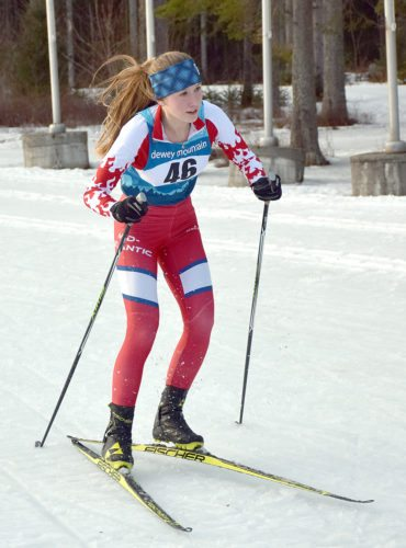Saranac Lake sophomore Sylvie Linck crosses the line to claim the Section VII individual girls title Thursday afternoon at Mount Van Hoevenberg in Lake Placid. (Enterprise photo — Justin A. Levine)