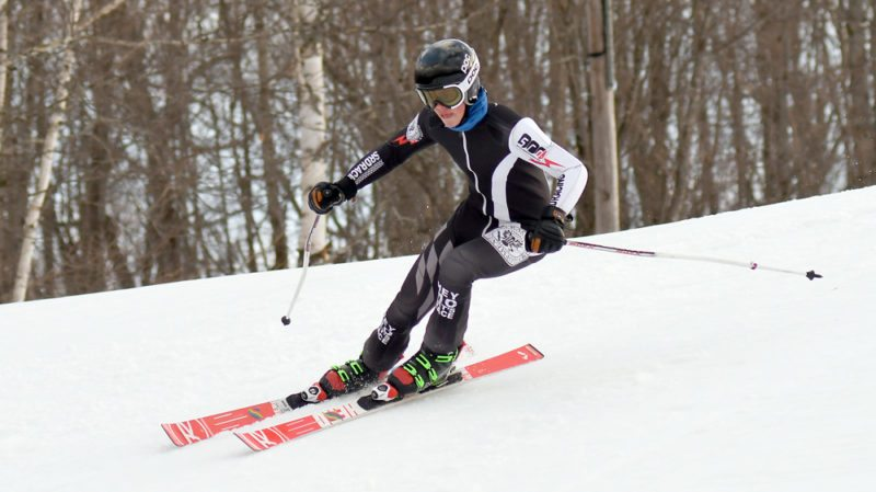 Gunnar Anthony of Lake Placid nears a gate during Thursday's Section VII championship giant slalom race at Mount Pisgah. (Enterprise photo — Lou Reuter)