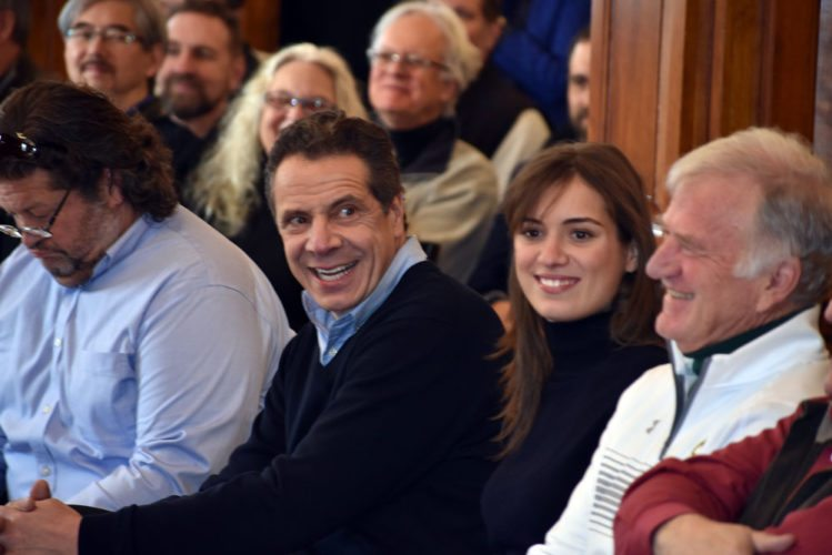 Gov. Andrew Cuomo laughs next to his daughter Mariah Kennedy Cuomo, Clarkson University President Tony Collins, right, and Hotel Saranac co-owner Fred Roedel III, left, on Saturday in the Hotel Saranac's Ballroom in Saranac Lake. (Enterprise photo — Peter Crowley)