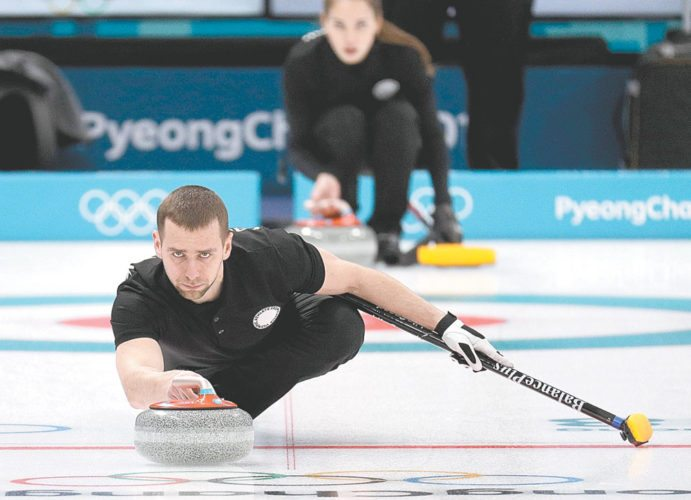 Russian curler Alexander Krushelnitsky practices Feb. 7 ahead of the 2018 Winter Olympics in Gangneung, South Korea. Russian curlers say a coach on their team told them that mixed doubles bronze medalist Krushelnitsky tested positive for a banned substance at the Pyeongchang Olympics. (AP photo — Aaron Favila)