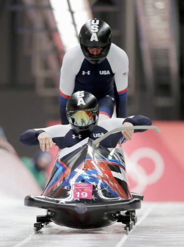 Justin Olsen and Evan Weinstock of the United States start their third heat during the two-man bobsled final Monday in Pyeongchang, South Korea. The duo was the top American team with a 14th-place finish. (AP photo — Wong Maye-E)
