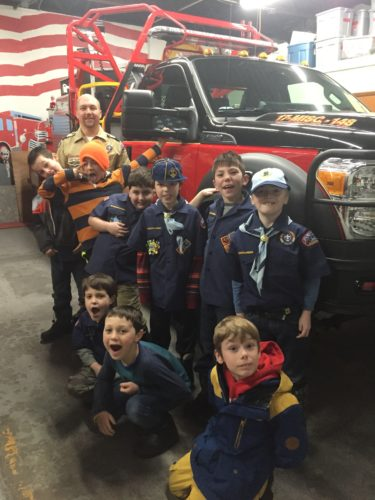 Pack 9 Bear Scouts started the year out by working on fire prevention and planning skills. They recently visited the Saranac Lake Volunteer Fire Department. Pictured, from left, are Den Leader  Jamie Laubach, Jayden Clark, Sam Duprey, Max Karp, Jackson Laubach, Gavin Stevens and Jimmy Braiddy. Kneeling are Owen Hybicki, Ethan Fletcher and Austin Warner. (Photo provided)