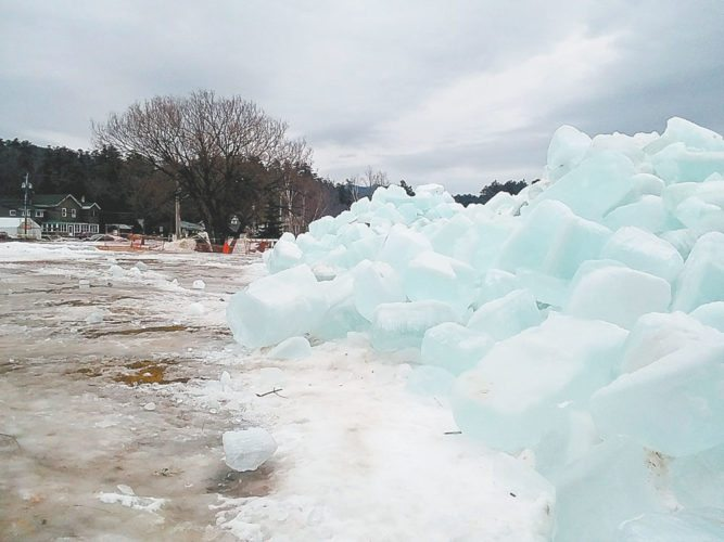 Saranac Lake Winter Carnival personnel dismantled the Ice Palace Sunday, deeming it no longer safe. They thanked all the volunteers who helped turn lake water into a palace and look forward to next year, when the Ice Palace will rise again.  (Enterprise photo —  Glynis Hart)