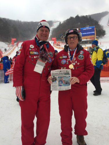 Lake Placid residents Chris Jacob, left, and Dr. Denis Chagnon of Mountain Medical Urgent Care pose with a copy of the Adirondack Daily Enterprise featuring Lake Placid biathlete Lowell Bailey, as well as Whiteface Mountain patches, Saranac Lake Winter Carnival buttons and other Adirondack mementos at the Winter Olympic women's slalom alpine ski event in South Korea. (Photo provided by Chris Jacob)
