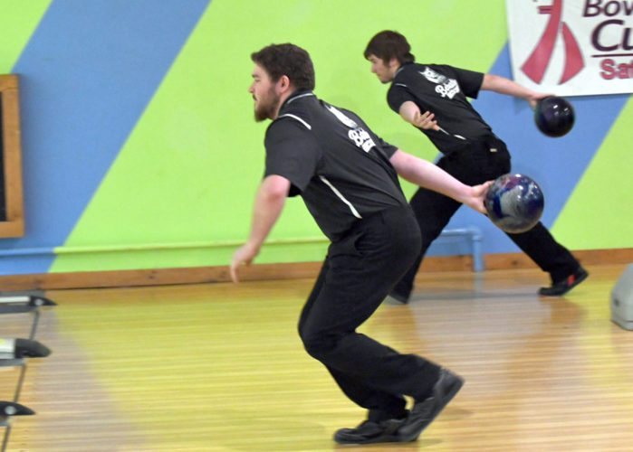 Senior Jordan Graffius, front, and junior Jon Herrman bowl for Paul Smith's College Sunday against Castelton State in a dual match at Romano's Saranac Lanes. The Bobcats won the match by 88 pins. (Enterprise photo — Lou Reuter)