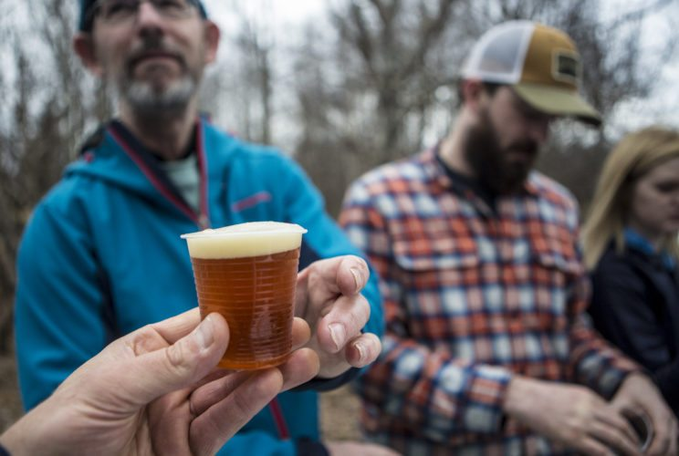 A brewer serves craft beer during the Brew-ski at the Tupper Lake Golf Course. (Photo provided — ROOST)