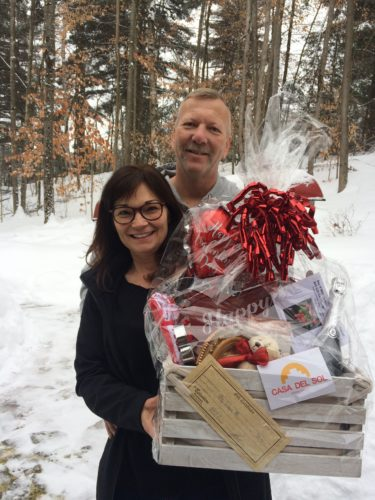 Rene and Tony Callahan were the winners of the Saranac Lake Women's Civic Chamber raffle basket. The basket includes chocolate, champagne, and gift certificates supporting local businesses, all donated by the organization's members, and valued at more than $150. Over 60 years ago, the Saranac Lake Women's Civic Chamber was formed by a handful of community-spirited women with the ambition of assisting the village Chamber of Commerce. Guided by a mission of civic improvement and youth welfare, members donate many hours to community service throughout the year. Proceeds from this and other fundraisers are given back to the community in the form of mini-grants to various local organizations. (Photo provided)