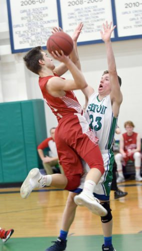 Emery Swanson of Saranac Lake drives to the basket while Foster Ovios defends for Seton Catholic during the second half of Wednesday's game in Plattsburgh. (Enterprise photo — Lou Reuter)
