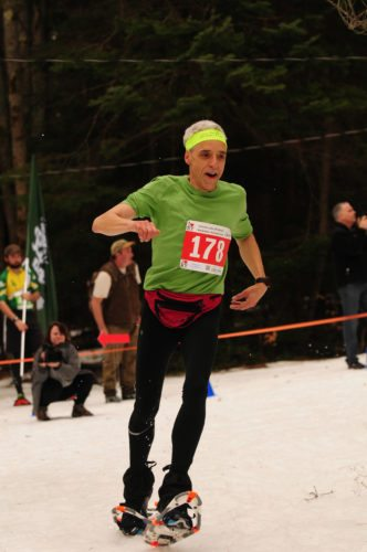 Daniel Edelstein races in the 2017 World Snowshoe Championships in Saranac Lake.  (Enterprise photo — Lou Reuter)