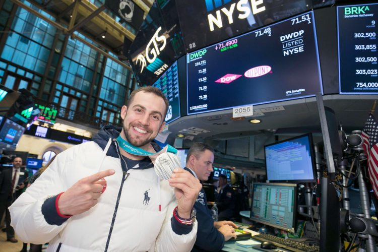 Chris Mazdzer, of Saranac Lake, stands on the floor of the New York Stock Exchange with his Olympic silver medal after ringing the opening bell to start the day's trading Thursday in New York City. (Photo courtesy of the New York Stock Exchange)