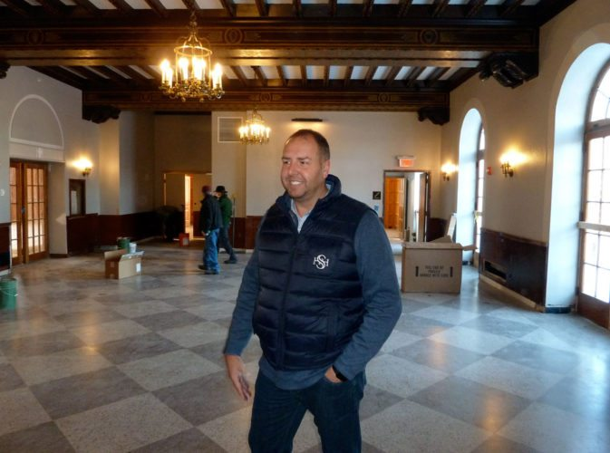 Hotel Saranac General Manager Michael Salyers, who was dismissed Tuesday, leads reporters theough the Great Hall during a tour in November 2017. (Enterprise photo — Peter Crowley)