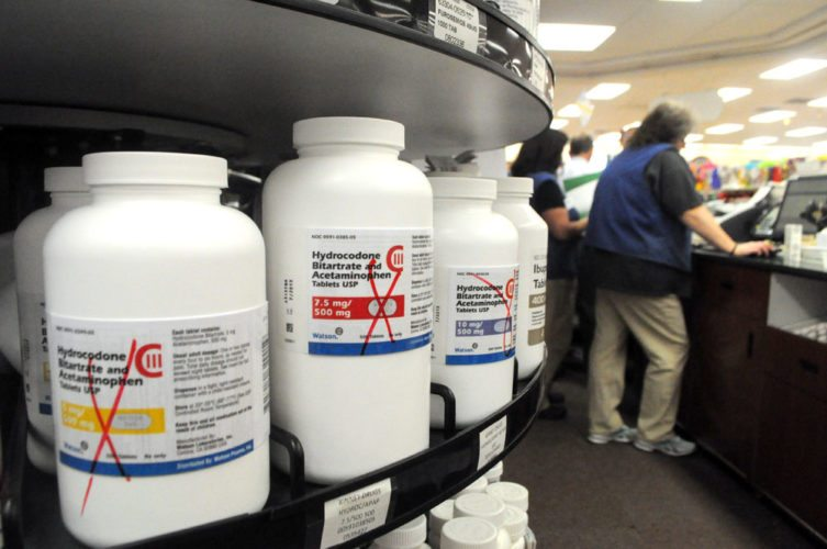 Bottles of hydrocodone, an opioid painkiller, are kept behind the pharmacy counter at Kinney Drugs in Saranac Lake in November 2011. (Enterprise photo — Chris Knight)