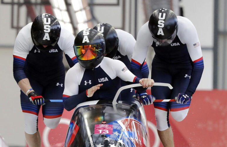 Driver Codie Bascue, Steven Langton, Samuel Mc Guffie and Evan Weinstock of the United States start their third heat during the four-man bobsled competition final at the Winter Olympics Sunday in Pyeongchang, South Korea. (AP photo -  Wong Maye-E)