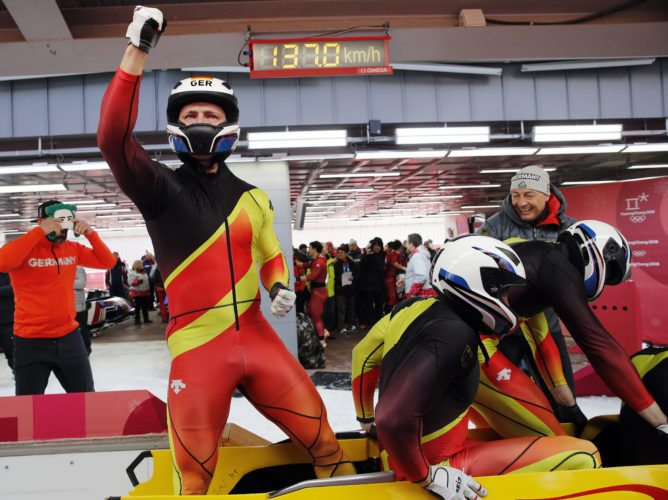 Driver Francesco Friedrich, Candy Bauer, Martin Grothkopp and Thorsten Margis of Germany celebrate their gold medal finish during the four-man bobsled competition final at the Winter Olympics in Pyeongchang, South Korea, Sunday. (AP photo -  Christophe Ena)
