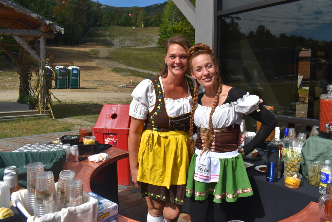 Whiteface Mountain Ski Center employees Amanda Cassidy (right) and Amy  Luebbers pose in German clothing during Oktoberfest Sunday.