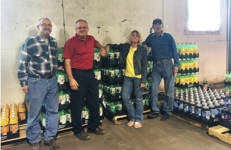 PHOTO BY ERIKA PLATT-HANDRU Greg Swartz, Scott Swartz, Karen Swartz and Steve Swartz stand inside S&S Variety Beverage. The business is set to close Sunday.