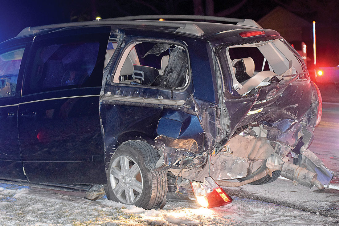 PHOTO BY JILL GOSCHE A 2006 Nissan Quest was struck in the rear by a car on SR 18 in Hopewell Township Monday evening.