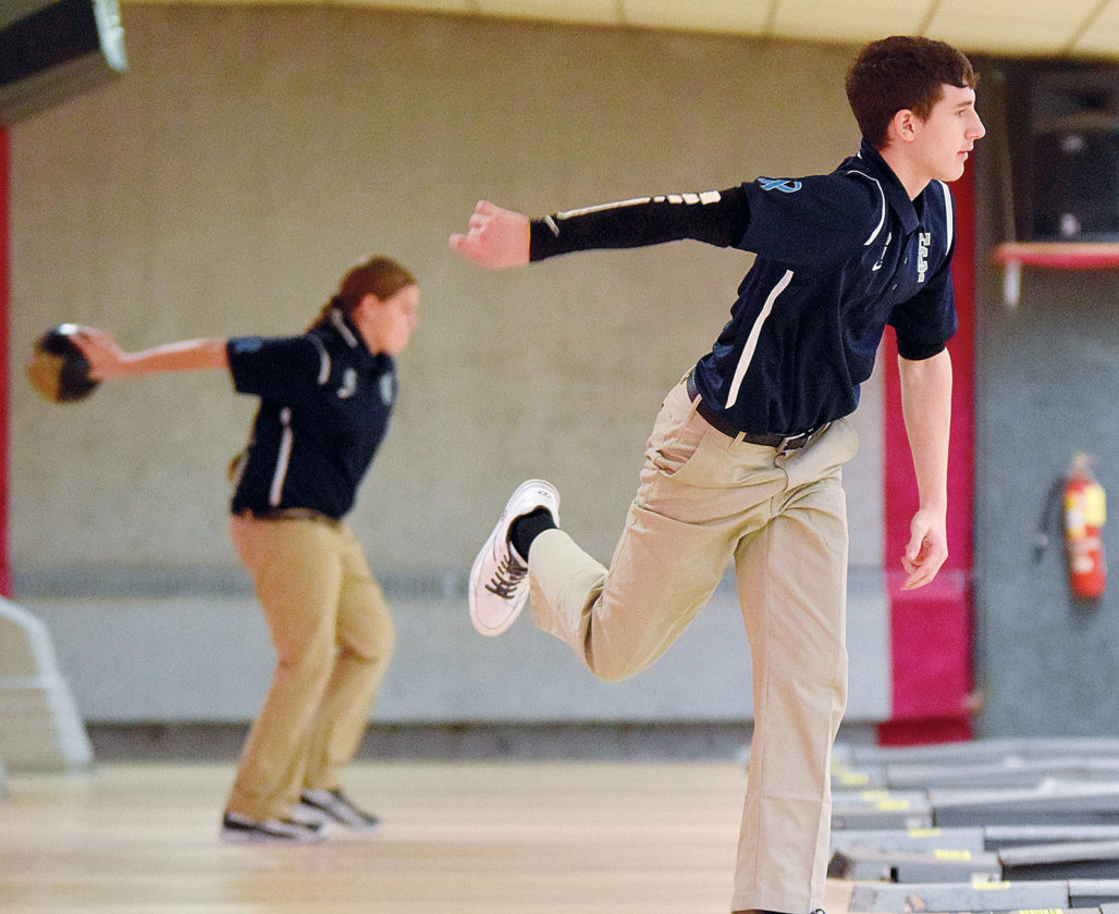PHOTO BY JILL GOSCHE Columbian's Kyler Krupp (right) and Ariel Hollins bowl during the match against Woodmore at Heritage Lanes Monday.
