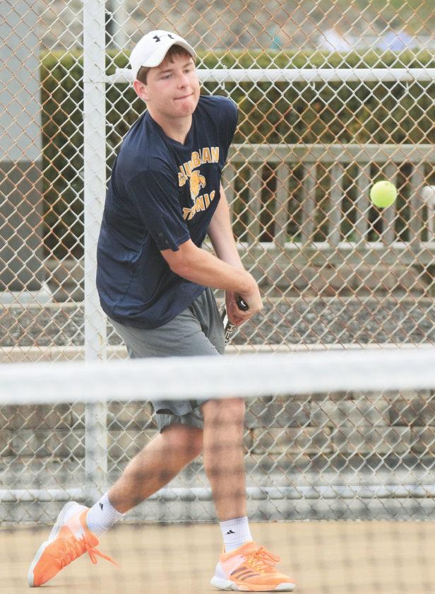 PHOTO BY JILL GOSCHE  Columbian's Ben Klepper hits the ball during a tennis match against Ross in Tiffin Wednesday.
