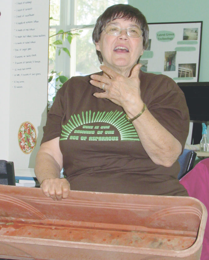 Sister Rita gestures while speaking earlier this month at the Franciscan Earth Literacy Center about square-foot organic gardening.