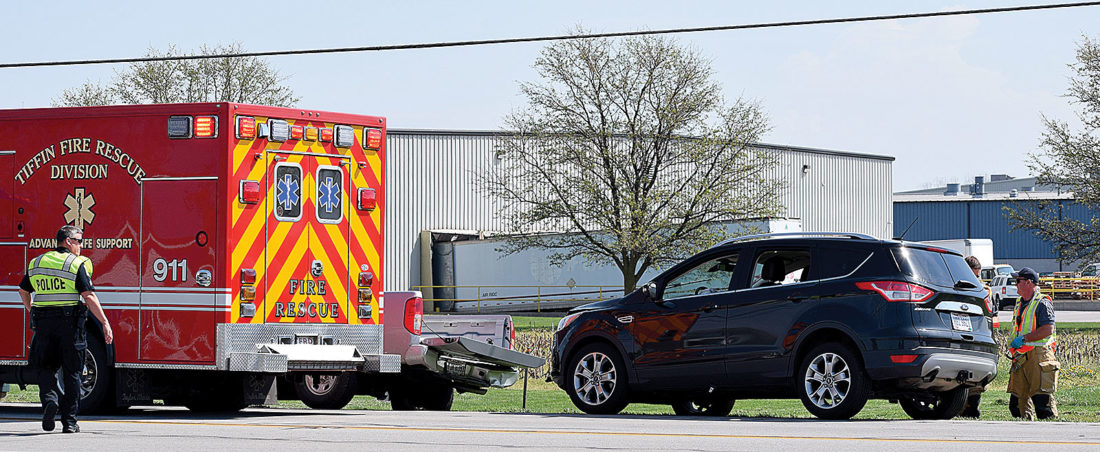 PHOTO BY JILL GOSCHE Tiffin Police Department and Tiffin Fire Rescue Division personnel work at the scene of an accident on North Sandusky Street at Tiffin's city limits Thursday morning.