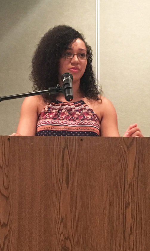 PHOTO BY NICOLE WALBY Tiffin Columbian High School senior Jada Reavers discusses the impact former coach Amy Cooper had on her life Thursday during Tiffin City Schools' Excellence in Education dinner.