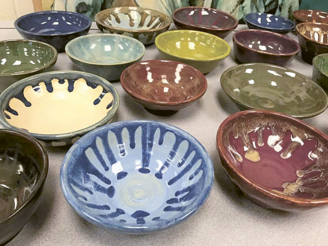 PHOTO SUBMITTED Pictured are some of the glazed ceramic bowls students in the New Riegel art club created for the Empty Bowls project.