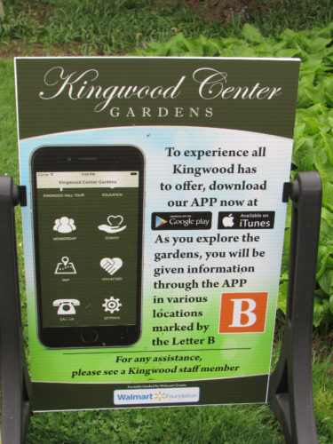 Signage prompts visitors to use smartphones to guide them through Kingwood Center Gardens.
