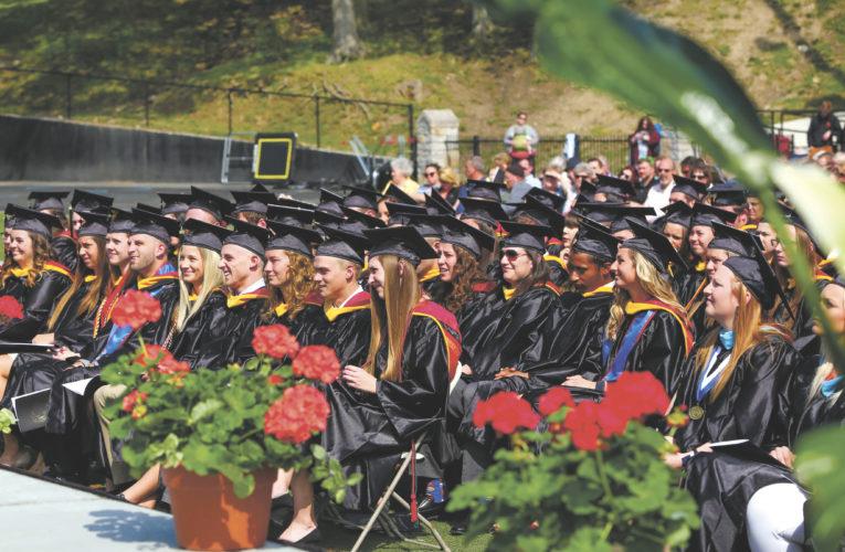 "Heidelberg University graduating class (above) listens to graduate student Brady Gibson speak on, ""It's about the journey, not the destination."""