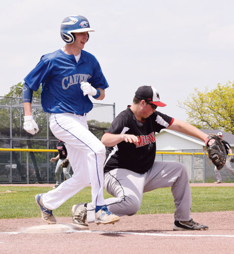 PHOTO BY JILL GOSCHE Calvert's Connor Kennedy is safe at first base as Mohawk's Carson Weinandy tries to get the out during the district semifinal game in Clyde Wednesday.