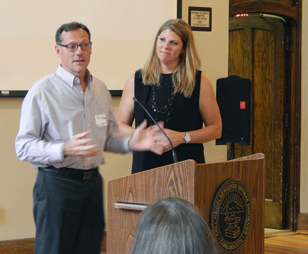 PHOTO BY JIMMY FLINT Rick Reser and Renee Perry, co-owners of The Empire at 138, accept a Main Street TiffinAward Thursday night for their spirit of revitalization, during the third annual Tiffin Downtown Summit.
