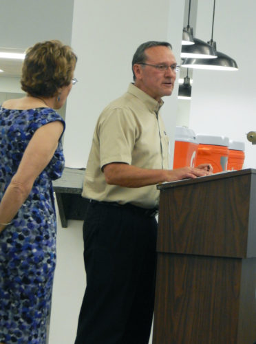 PHOTO BY NICOLE WALBY Tiffin-Seneca County United Way 2016-17 Campaign Chairman Kevin Reser discusses the year's campaign Thursday at National Machinery. Pat DeMonte looks on.