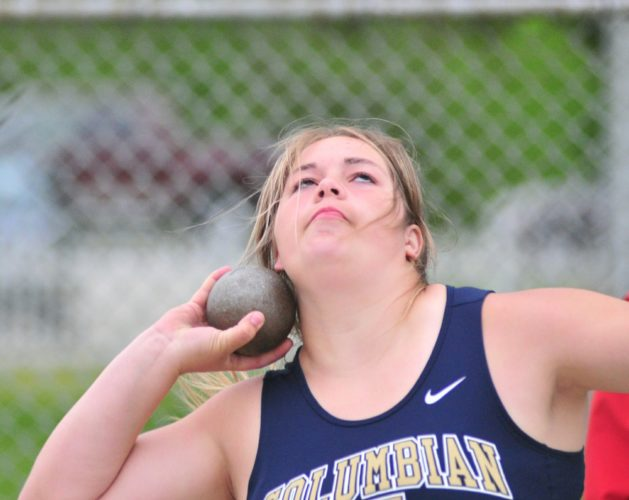 Photo by Pat Gaietto Columbian's Brook Boes throws the shot put a distance of 30-1 1/2 Friday in the Division I district meet in Tiffin.