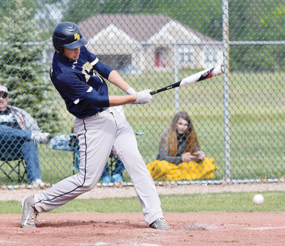 PHOTO BY JILL GOSCHE  New Riegel's Brandon Arbogast hits during the district final game against Calvert in Clyde Saturday.