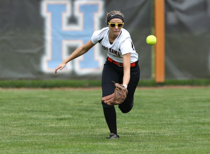 PHOTO BY STEVE WILLIAMS Madi Vince closes in on a short shot to centerfield Saturday in Milan.