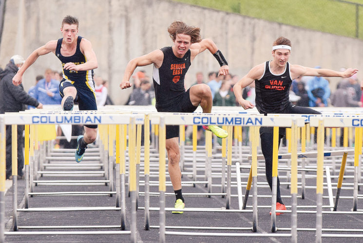 PHOTO BY JILL GOSCHE Seneca East's Garrick Manning (center) competes in the 110-meter hurdles during the regional track meet at Frost-Kalnow Stadium Wednesday. He qualified for Friday's finals. Also racing are Archbold's Deven Girdham (left) and Van Buren's Tyler Saltzman.