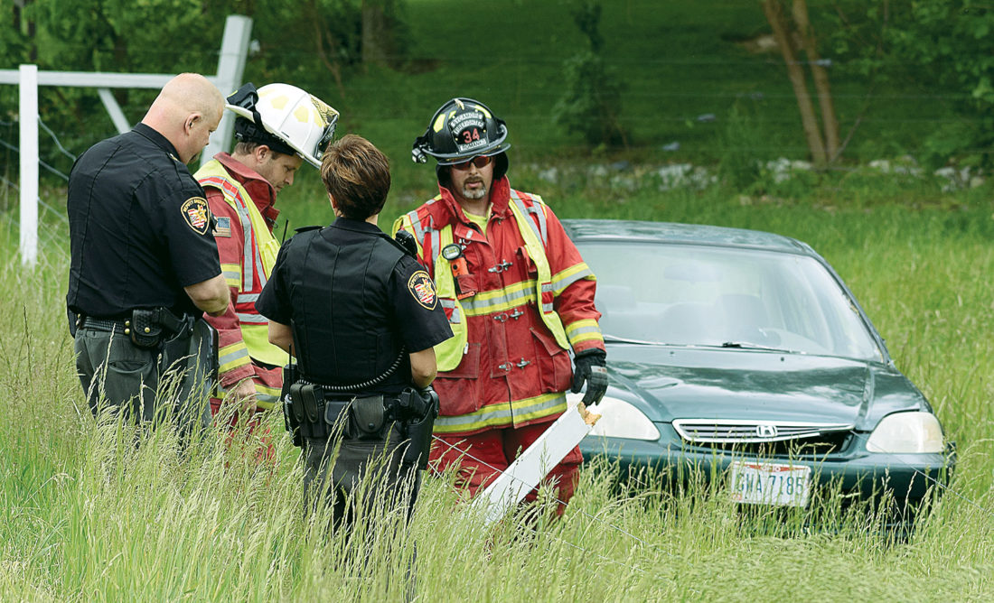 PHOTO BY JILL GOSCHE Rescue personnel work at the scene of an accident on TR 151 Wednesday afternoon.