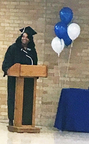 PHOTO BY NICOLE WALBY Chantel Branch speaks to fellow graduates Wednesday evening at the Gateway and GED graduation ceremony at the Adult Workforce Development Center.