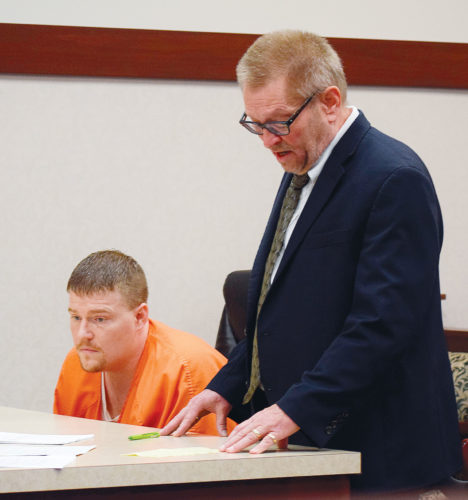 PHOTO BY JILL GOSCHE Attorney Thomas Nicholson (right) stands next to Matthew Keckler during Keckler's sentencing hearing in Seneca County Common Pleas Court Judge Michael Kelbley's courtroom Thursday afternoon.